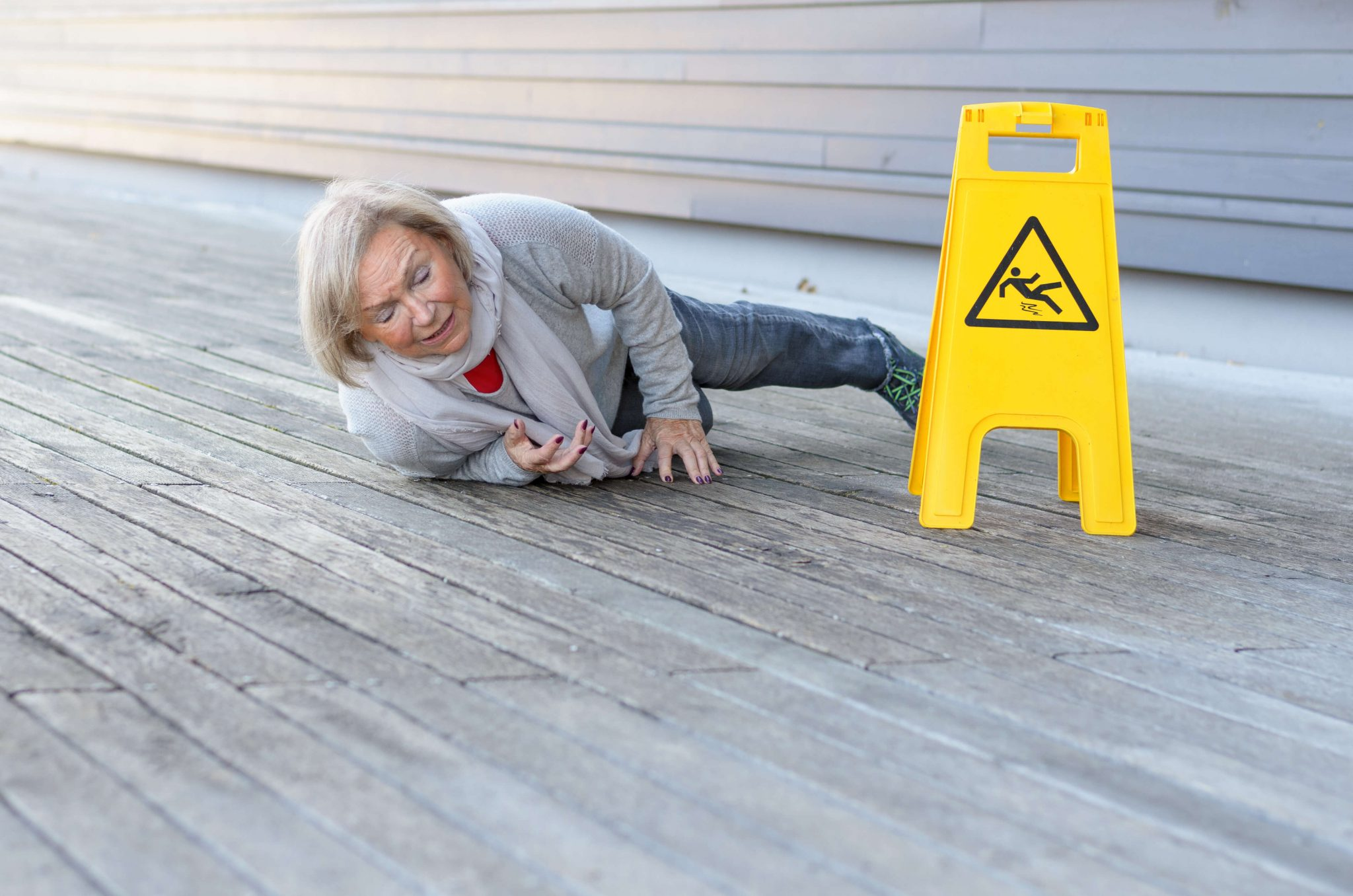 Picture of a Lady Slipping and Falling on a Wet Floor