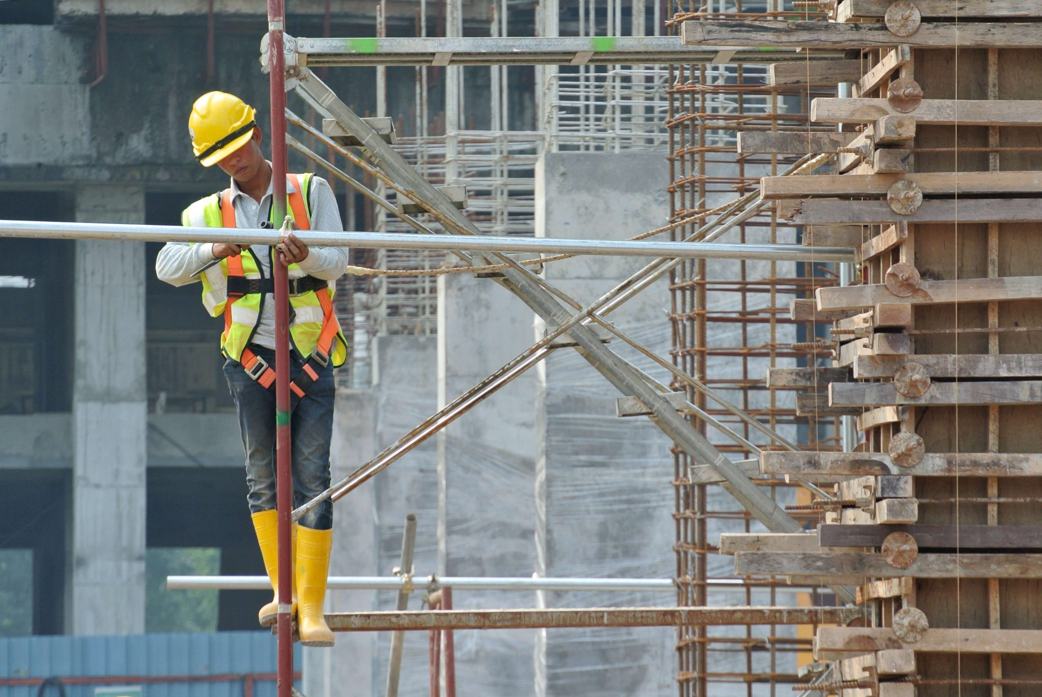 Photo of a Construction Worker on Scaffolding
