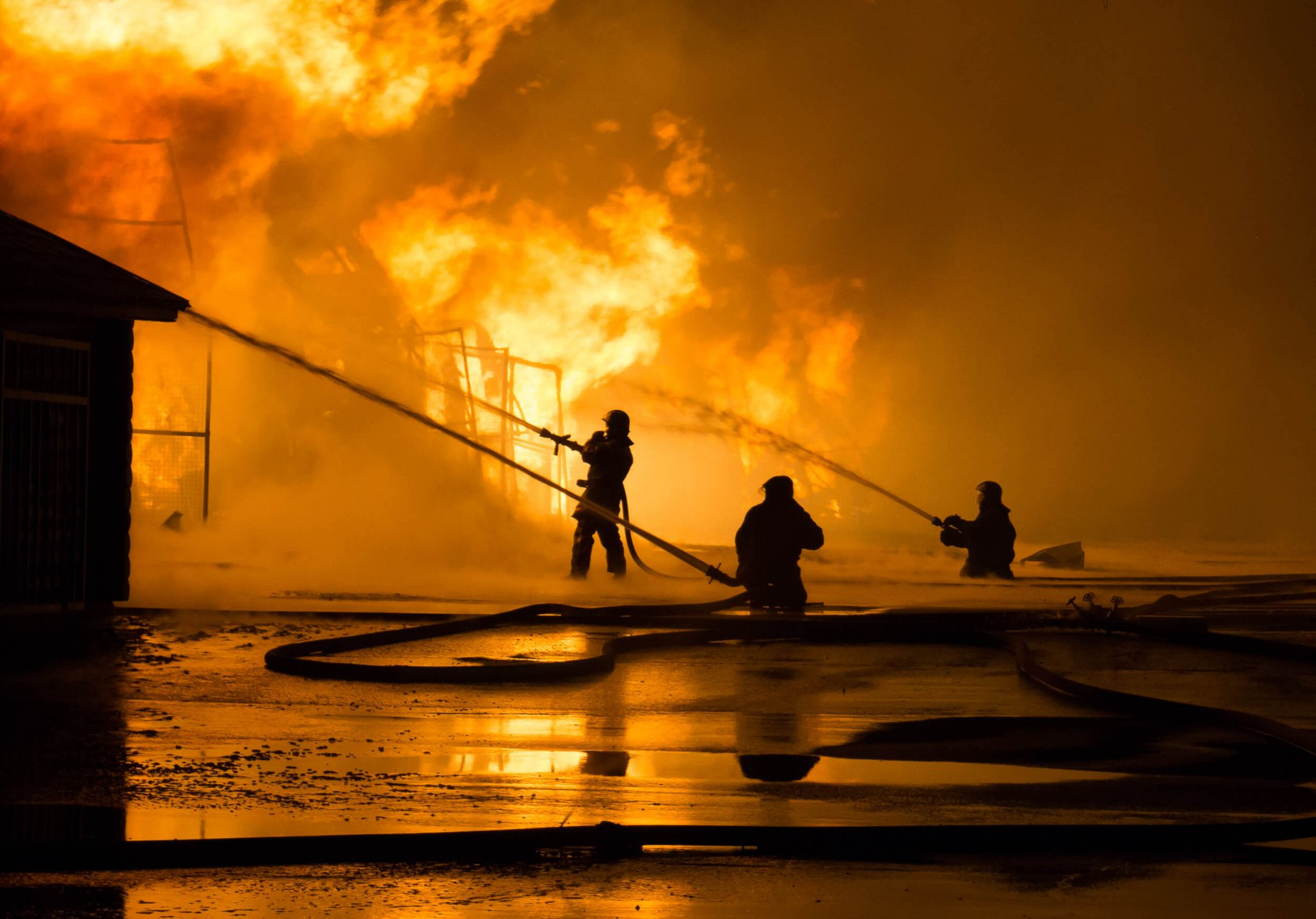 Photo of Firemen at work on fire