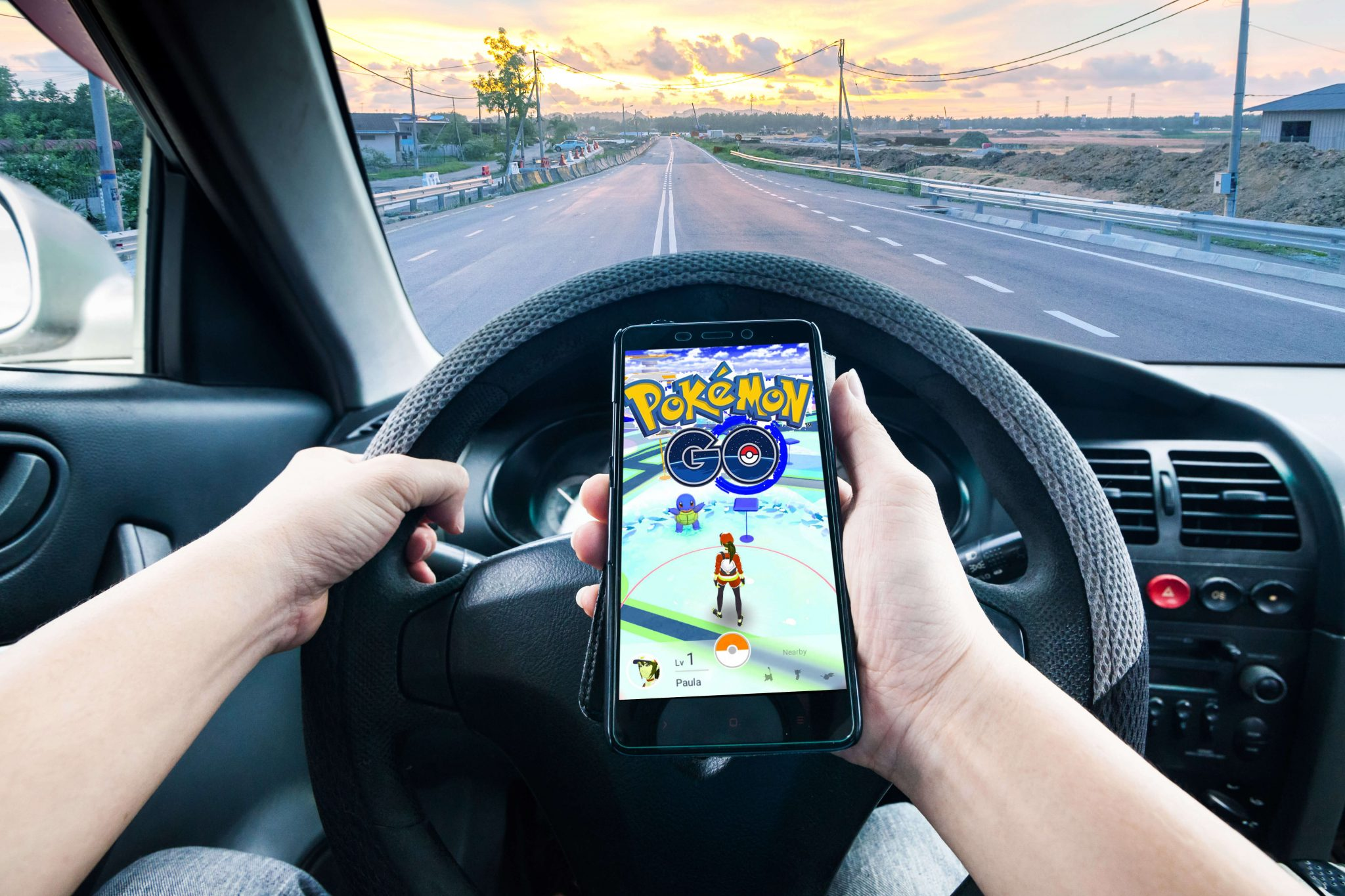 Picture of Someone Playing a Cellphone Game While Driving